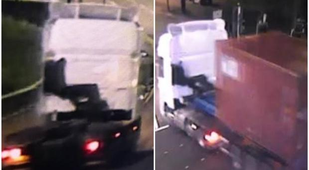 A white-coloured cab with blue trailer was seen carrying a red container on Renfrew Road towards the M8 shortly after the incident (Police Scotland/PA)