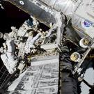 Nasa astronauts Christina Koch and Jessica Meir exit the International Space Station (Nasa via AP)