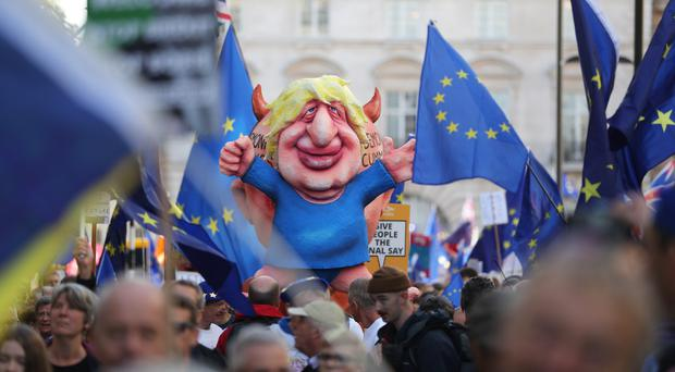Protesters pull a float depicting Prime Minister Boris Johnson (Andrew Matthews/PA)