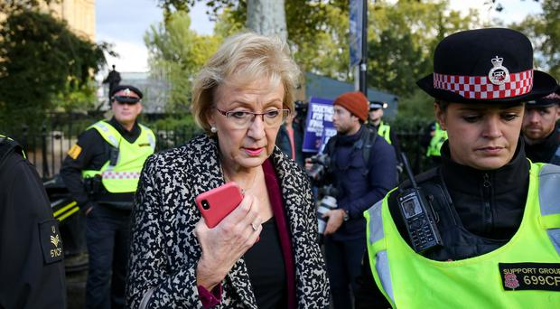 Business Secretary Andrea Leadsom is escorted by police officers in Parliament Square, London (Jacob King/PA)