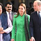 The Duke and Duchess of Cambridge walk alongside Imran Khan (Andrew Parsons/PA)