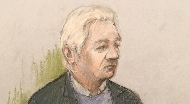 Courts artist sketch of Julian Assange at Westminster Magistrates' Court (Elizabeth Cook/PA)