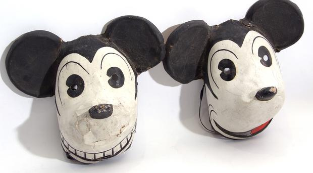 Two rare 1930s Mickey Mouse masks that were made in Germany under licence from the Walt Disney company (Andy Newman/ PA)