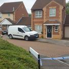 Police at a housing estate in Emerson Valley, Milton Keynes, where two teenage boys were stabbed to death (Gus Carter/PA)