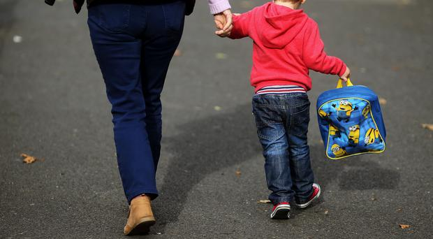 A woman and a child (Brian Lawless/PA)