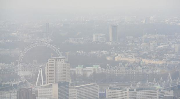 A view over London through a layer of smog (Nick Ansell/PA)