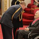 Photographer Terry O'Neill is made a CBE by the Duke of Cambridge at Buckingham Palace (Jonathan Brady/PA)