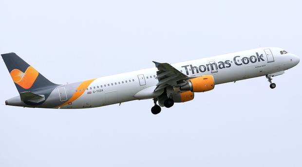 A former Thomas Cook boss has denied saddling the firm with a debt mountain after a mammoth expansion drive (Tim Goode/PA)