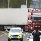 The lorry where 39 people were found dead inside leaves Waterglade Industrial Park in Grays (Aaron Chown/PA)