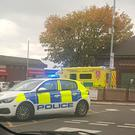 Handout photo taken with permission from the Twitter feed of DamiLola B Soyoye of police at the scene in Harpurhey after they responded to reports of a stabbing in a McDonalds. (DamiLola B Soyoye/PA)