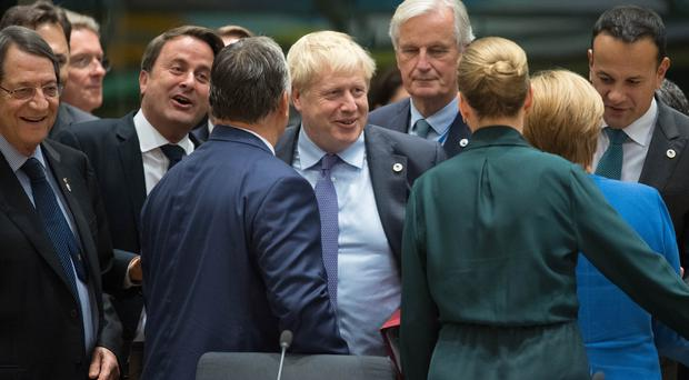EU leaders are considering whether to grant a Brexit delay against Boris Johnson's wishes (Stefan Rousseau/PA)