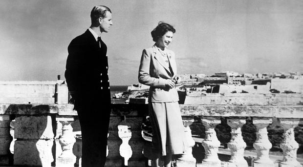 Princess Elizabeth, accompanied by the Duke of Edinburgh, looking over Valetta from the roof of the Villa Guardamangia in Malta in 1949 (PA)