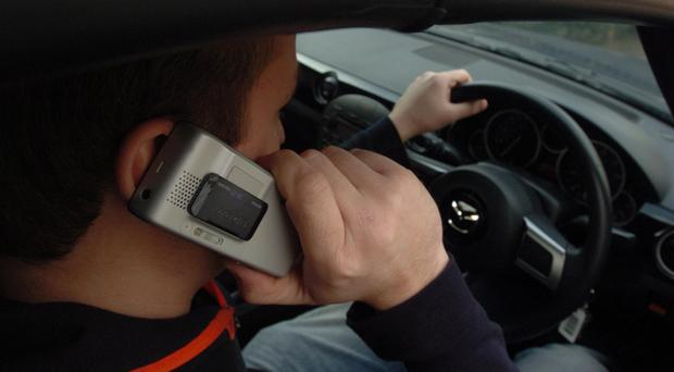 Fines for motorists caught using a hand-held phone were doubled in March 2017 (Barry Batchelor/PA)