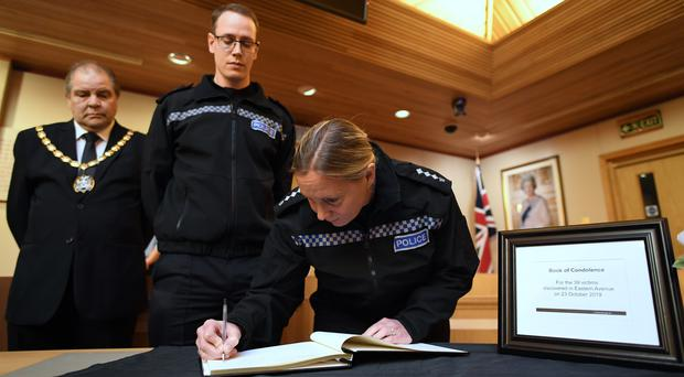 (left to right) Mayor of Thurrock Terry Piccolo, Superintendent Craig Saunders and Chief Inspector Claire Talbot (both of Essex Police) sign the Book of Condolence (Stefan Rousseau/PA)