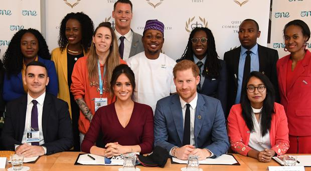 The Duke and Duchess of Sussex during a roundtable discussion on gender equality with the Queen's Commonwealth Trust and One Young World at Windsor Castle (Jeremy Selwyn/Evening Standard/PA)