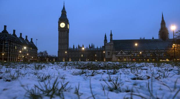Snow outside the Houses of Parliament in London (Anthony Devlin/PA)
