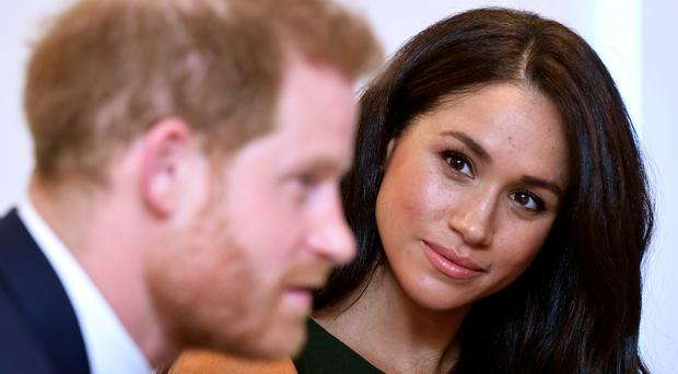 Harry made a surprise appearance alongside Meghan at a roundtable discussion she chaired (Toby Melville/PA)