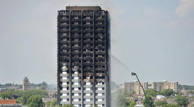 Grenfell Tower in west London (PA)