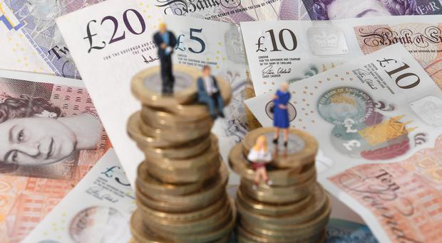 Figures show the gender pay gap for full-time workers in the UK has increased (Joe Giddens/PA)
