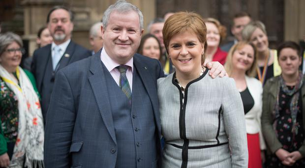 Nicola Sturgeon and the SNP's Westminster leader Ian Blackford will put the case for a second vote on independence at the heart of any election campaign (Stefan Rousseau/PA)