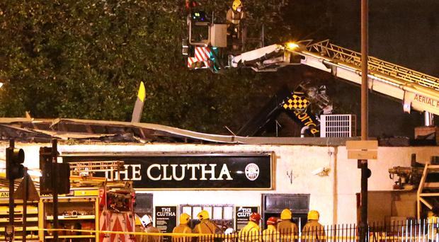 Emergency services at the scene of the helicopter crash at the Clutha Bar in Glasgow (Andrew Milligan/PA)