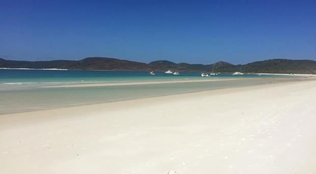 Whitehaven Beach on Whitsunday Island. Two British men snorkelling between Whitsunday Island and Hook Island were airlifted to hospital after being attacked by a shark (Ellie Cullen/PA)