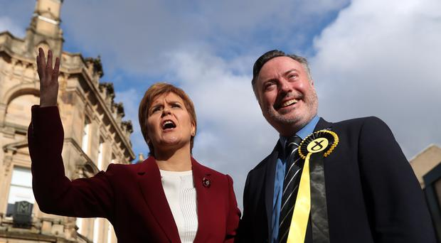SNP leader Nicola Sturgeon joins Alyn Smith, the SNP's candidate for Stirling, on the general election campaign trail in the city (Andrew Milligan/PA)