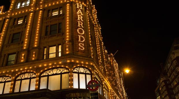 Christmas lights at Harrods in London. Harrods has announced plans to launch the new H Beauty brand (PA)