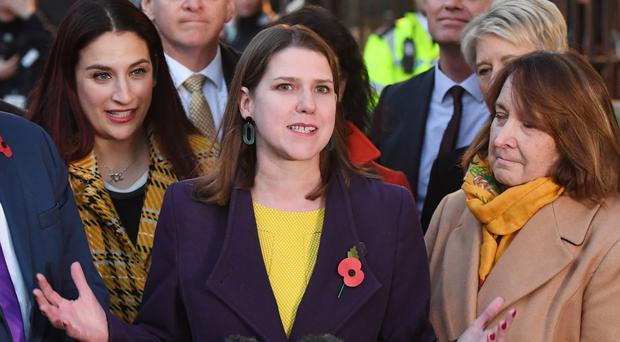 Jo Swinson with Liberal Democrat MPs outside the Houses of Parliament (Stefan Rousseau/PA)