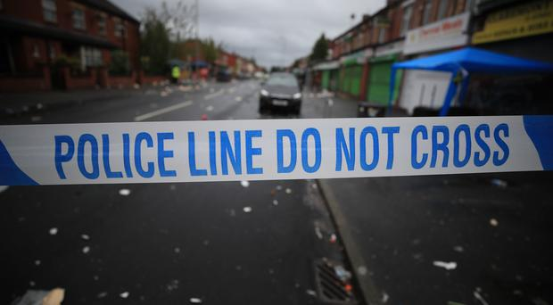Police were called to reports of two men acting suspiciously on Chapel Street in Salford (PA)