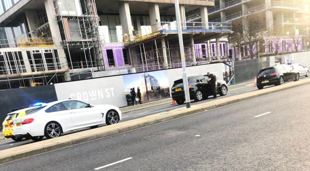 Two men in a Range Rover being stopped by police in Manchester city centre (Kris Meredith/Twitter/PA)