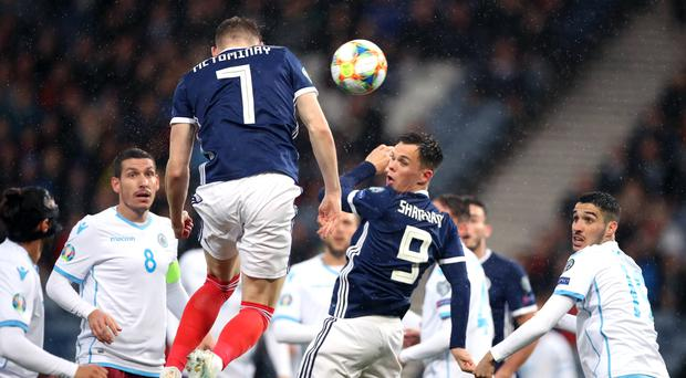 Scotland's Scott McTominay heads the ball during a Uefa Euro 2020 qualifying match against San Marino (Steve Welsh/PA)
