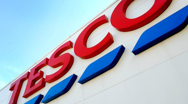 Tesco is to remove one billion pieces of plastic from products by the end of 2020 as it seeks to reduce its environmental impact (Nick Ansell/PA)