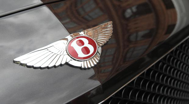 A family-run clothing firm has won a High Court case against Bentley Motors (Harry Hubbard/PA)