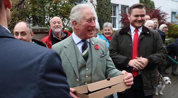 Charles laughed after being given the pizza (Andrew Milligan/PA)