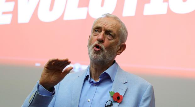 Jeremy Corbyn is accusing Boris Johnson of hijacking Brexit to sell out the NHS (Aaron Chown/PA)