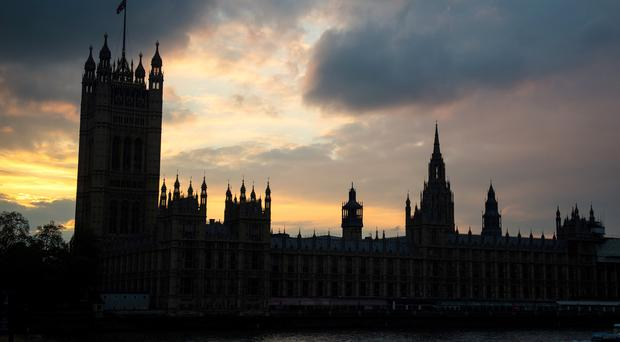 Sunset behind the Houses of Parliament (Dominic Lipinski/PA)