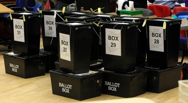 A row of ballot boxes (David Jones/PA)