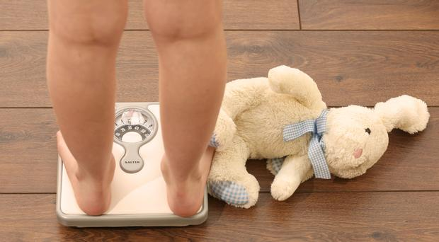 Only children are more likely to be obese than those with siblings, according to a study (PA)