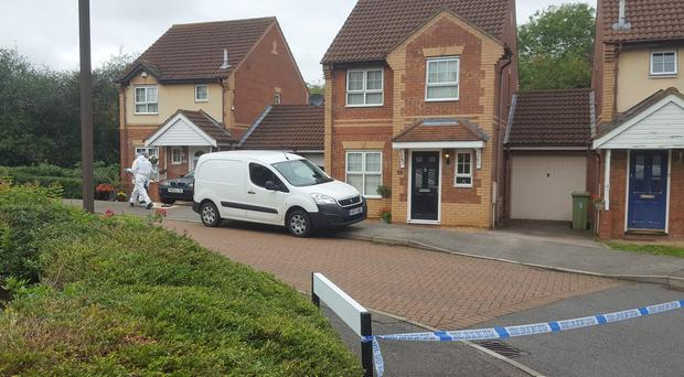 Police on the Emerson Valley estate in Milton Keynes, where two teenage boys were stabbed to death at a house party (Gus Carter/PA)