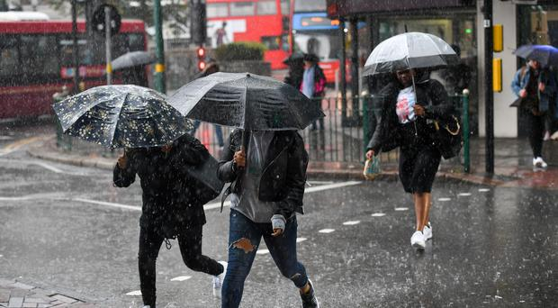 The Met Office warned of prolonged and occasionally heavy rain (Jacob King/PA)