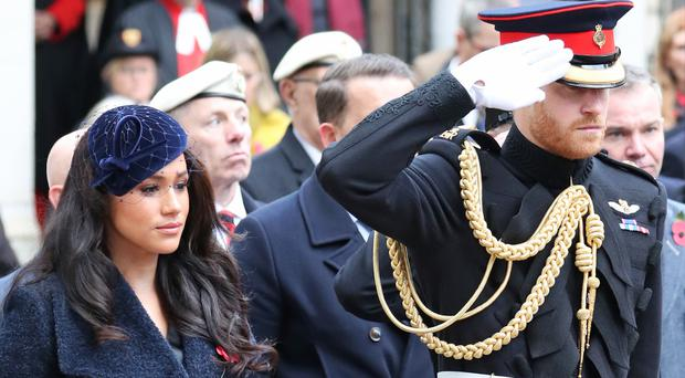 The Duke and Duchess of Sussex during a visit to the Field of Remembrance at Westminster Abbey (Steve Parsons/PA)