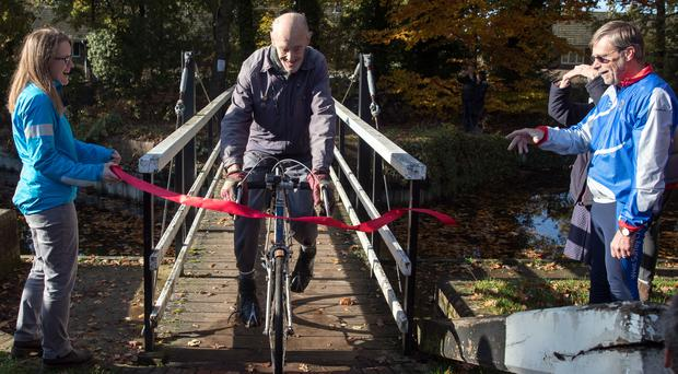 Russ Mantle from Aldershot cycles through finishing tape at the Canal Cafe in Mytchett, Surrey (Andrew Matthews/PA)