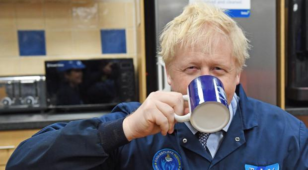 Prime Minister Boris Johnson drinks a cup of tea during a visit to the Tetley Tea factory in Stockton (Stefan Rousseau/PA)
