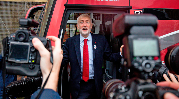 Labour leader Jeremy Corbyn unveils the party's battle bus while on the campaign trail in Liverpool