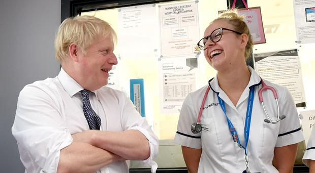 Boris Johnson meets staff and nurses during a visit to King's Mill Hospital in Sutton-in-Ashfield (Stefan Rousseau/PA)