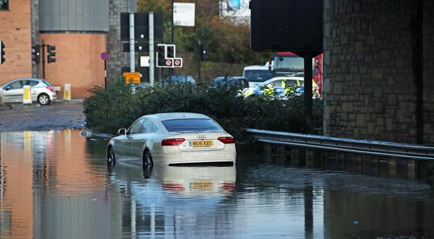 A car in floodwater near Meadowhall shopping centre in Sheffield (Danny Lawson/PA)