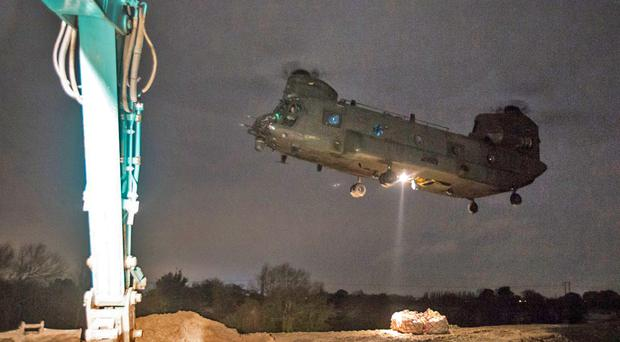 An RAF Chinook in Doncaster moving tonnes of aggregate (MoD/PA)