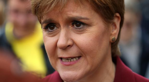 First Minister Nicola Sturgeon has defended the policy of writing handwritten notes on government policy which are then destroyed (Andrew Milligan/PA)
