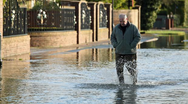 A man walks through floodwater in Fishlake near Doncaster (Danny Lawson/PA)